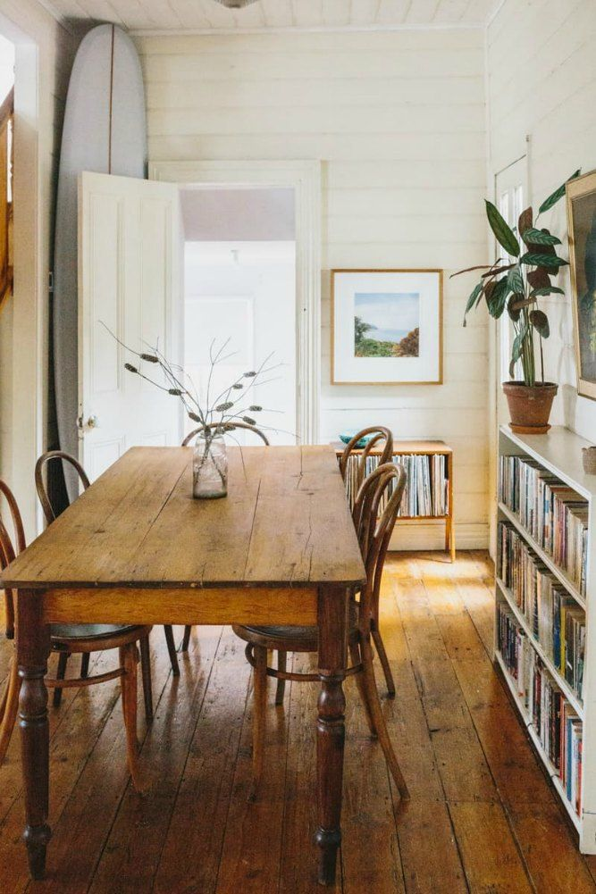 Modern Rustic Beach House Style Dining Room Featuring An Antique Wood Table,  Cafe Style Side Chairs, White Bookcases, And A Surf Board   Eclectic Home  ... Part 53