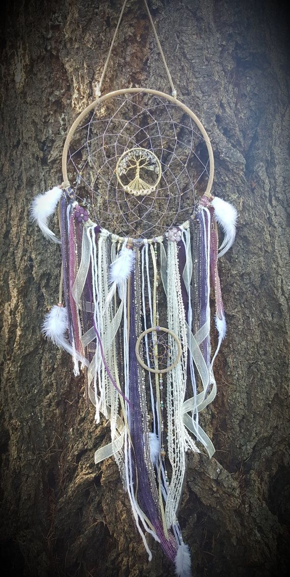 Boho Purple And White Tree Of Life Dream Catcher/Wall Hanging/Nursery Décor/Room Decor  Measurements: Large Dream catcher ring-10 diameter Tree of life-3 diameter Small Dream catcher ring 3 diameter Approx 40 top to bottom  Dream Catcher ring is wrapped with beige suede lace, webbing is made with pure hemp string in a purple color. Gold seed beads throughout webbing. Tree of life hand crafted with brass wire, amethyst and clear quartz chips. Along bottom of rings are six spirals each with a…