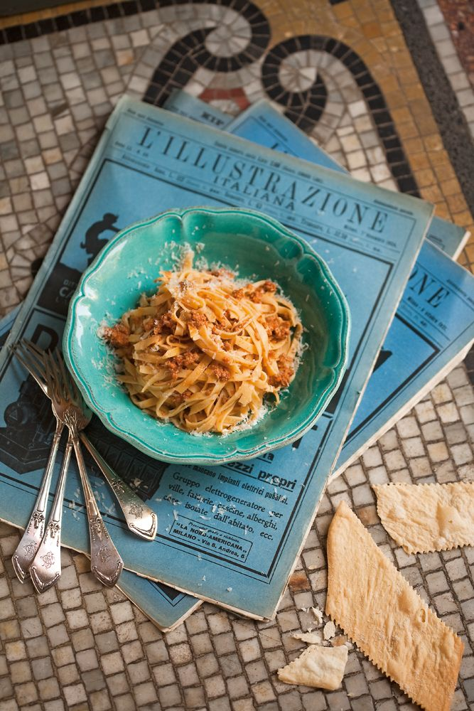Nothing insults the Bolognese people more than when their typical dish, Tagliatelle al ragu' Bolognese is called Spaghetti Bolognese!So do not make this mistake. Make plenty of fresh Tagliatelle and make sure you toss continuously with butter as you are add the glorious ragu'.Add freshly grated Parmigiano Reggiano and you have a ticket to heaven!