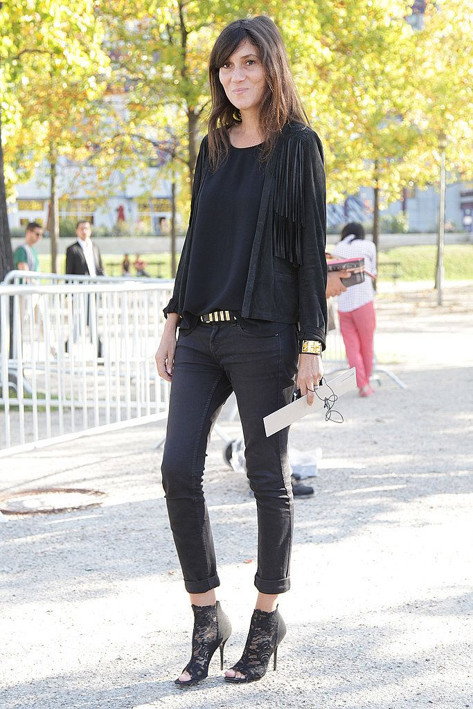 Emmanuelle Alt Street Style Pictures Gold accessories, straight black jeans, black tank with jacket and lacey boots.