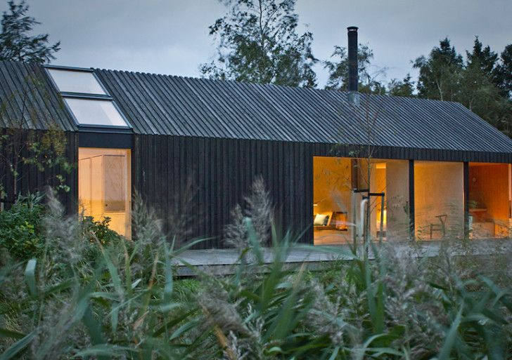 Situated in a quiet area about 350 meter from the water edge on Råbylille beach, the Black& Bright house was designed by German architect Ja...