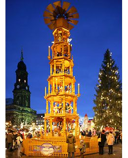 "Christmas Market in Dresden, Germany. Oldest continuous market in Germany - since 1434 ... features the 46' tall ""Christmas Pyramid"" pictured and wonderful crafts and decorations from all over Germany."