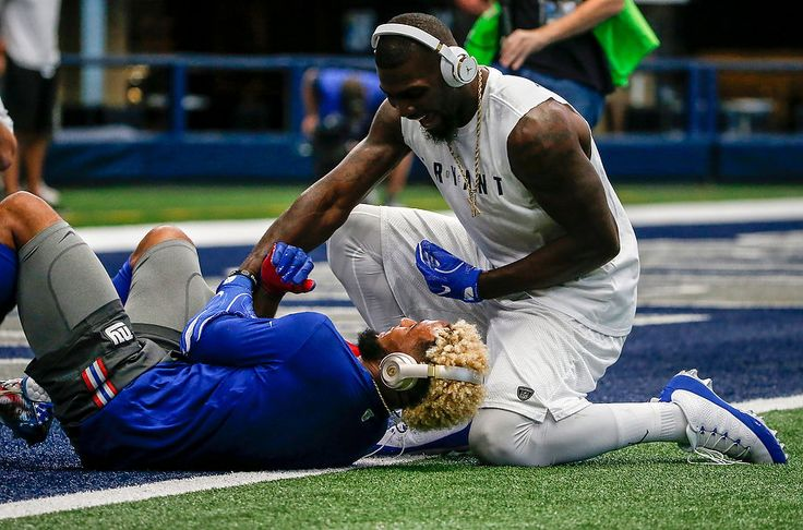 Dallas Cowboys Dez Bryant (88) playfully pounces on New York Giants Odell Beckham Jr. (13) as the two WRs put on a show for fans during pregame warmups before NFL Week 1 action in Dallas. 9/11/16 (Andrew Mills | NJ Advance Media for NJ.com)