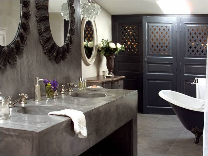 Grey bathroom. Love the mirrors and the unique doors!