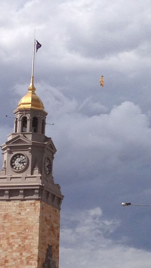 Gold topped town clock, on a stormy day - my own photo.