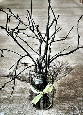 sticks spray painted and put in mason jar. Makes an amazing center piece!