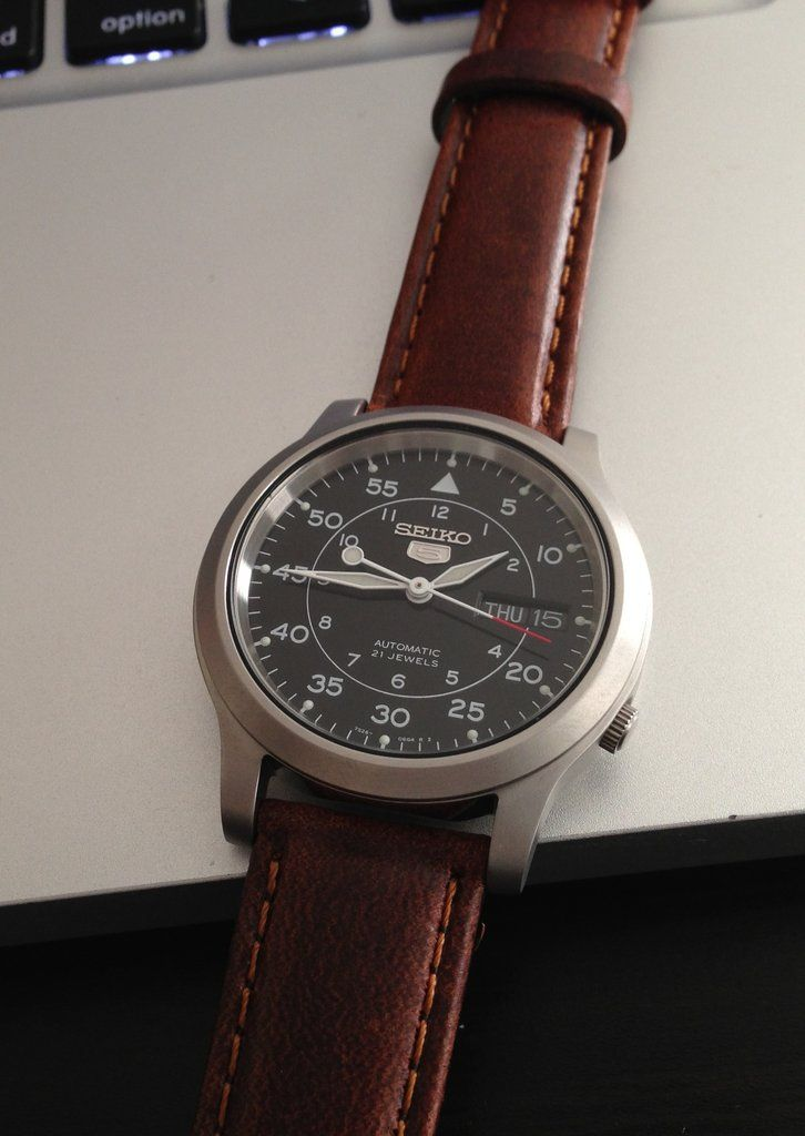 A Seiko SNK809 Type B Flieger pilot watch with exhibition caseback on a Hadley-Roma oil-tanned leather strap.