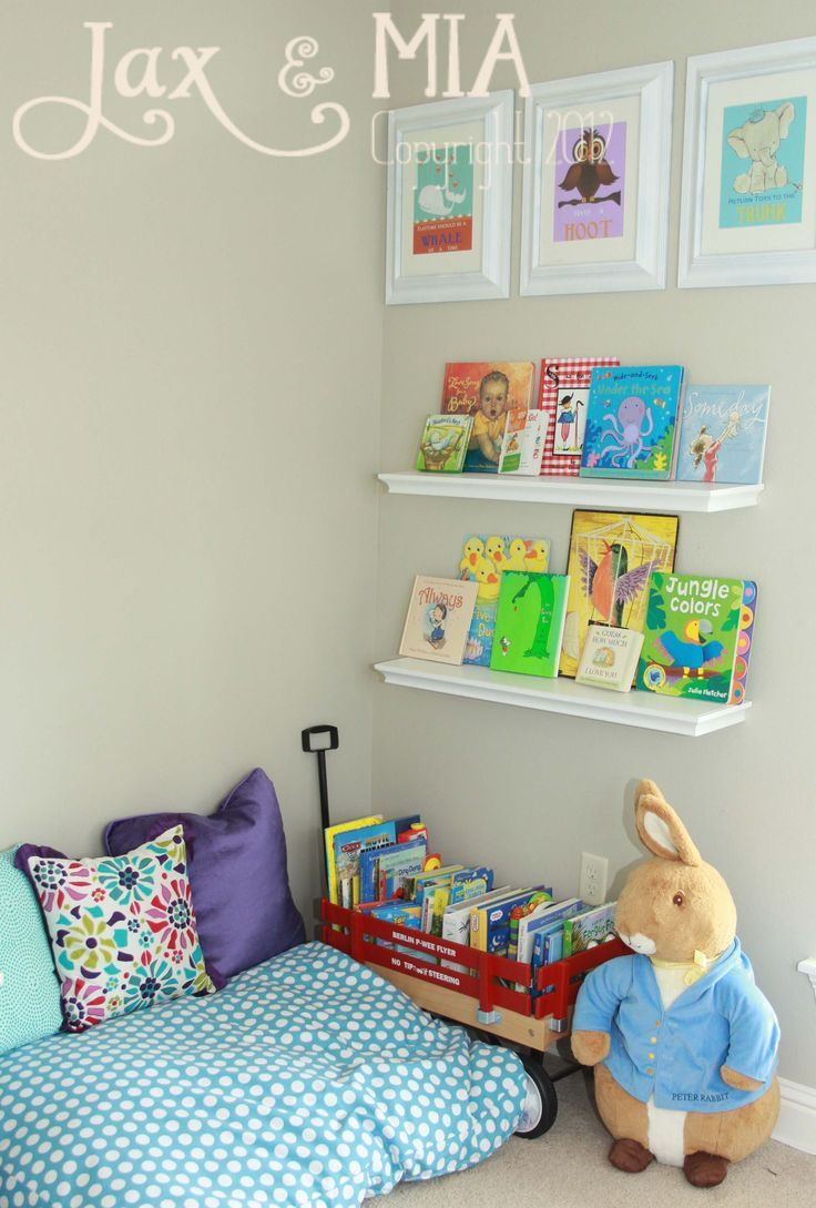 Reading corner idea. Use crib mattress in corner topped with mushroom, fox, and deer pillows. Find something interesting or use a crate with few pallets (so books are visable) to hold books.