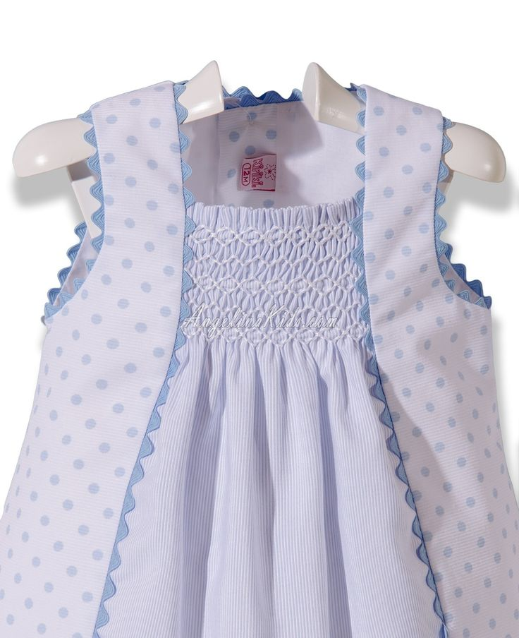 White and light blue embroidered dress. Lovely rickrack detail on the dress