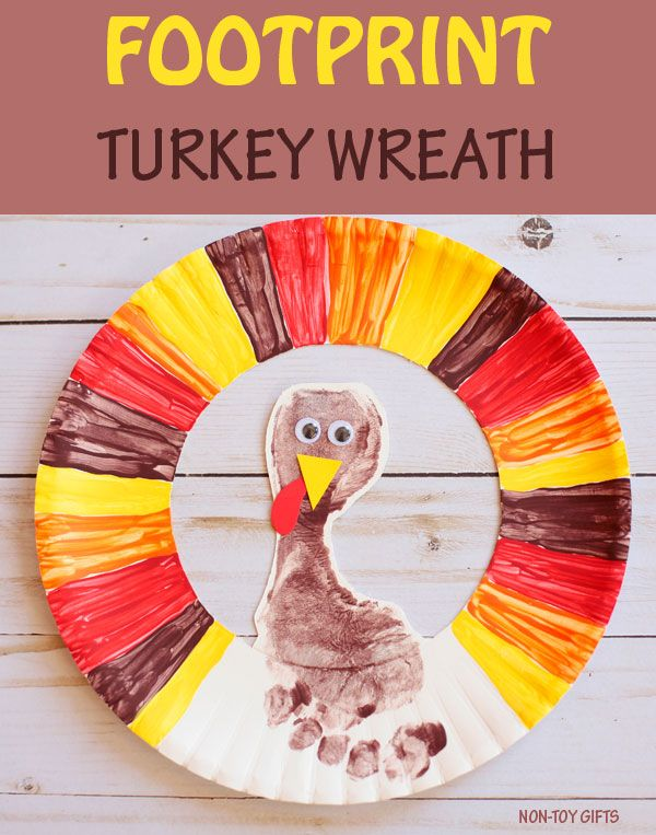 Footprint turkey wreath - easy Thanksgiving craft for kids to make with paper plate. #fall #thanksgiving #footprintart