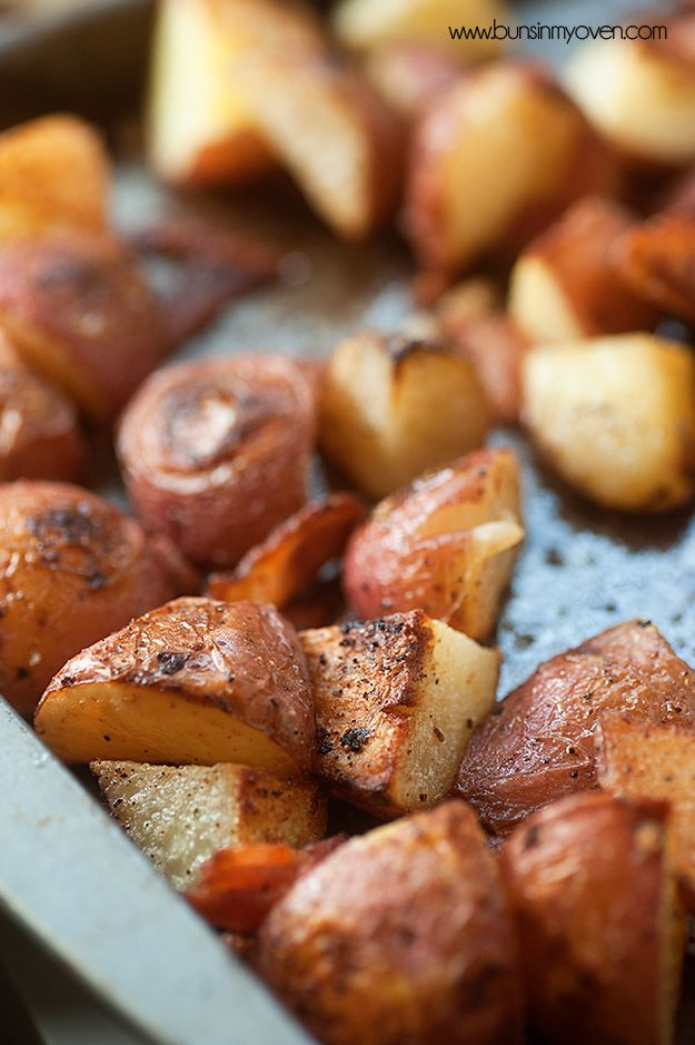 Oven Roasted Potatoes tossed in bacon grease, with garlic, parmesan, and crispy bacon pieces