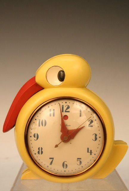 Belle Kogan's Quacker electric alarm clock, designed for Telechron Company in 1934. The case is made of Plaskon, an early plastic developed in 1931.  She also designed for Red Wing Pottery, among many others.