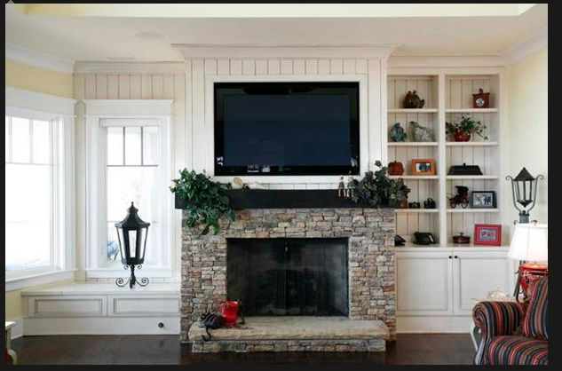 Dry stone fireplace with tv above