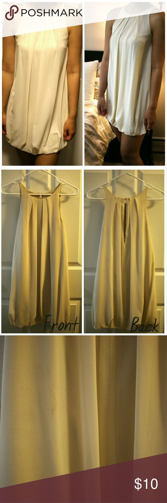 """Elegant Cream Party/wedding theme Dress Absolutely beautiful dress. Beautiful cream color. Nice and soft chiffon fabric. Very comfortable to wear and perfect for a night out. Has no size on it but would fit both S and M. Length is about 26"""" from top to bottom. It has small stain on the back as shown in the last photo but very hard to spot when you're wearing it. Only worn once or twice.    If you like it, feel free to send me an offer :) Korean Brand Dresses"""