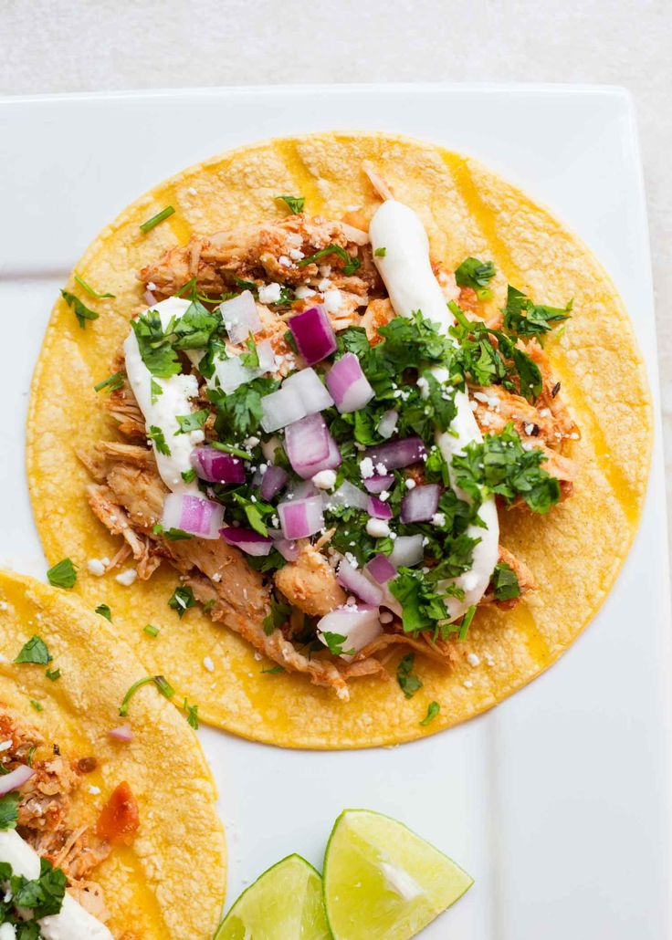 Slow Cooker Chicken Tinga Tacos, a recipe that tastes like it came straight from a Mexican restaurant. AMAZING!