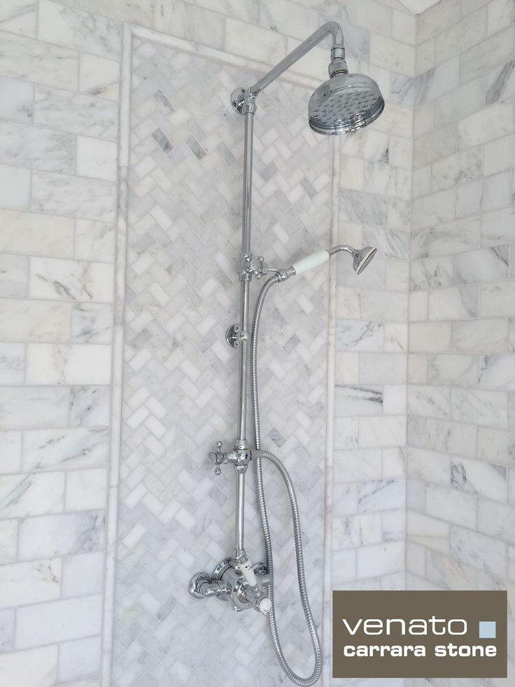 In the shower they chose Carrara Venato 3×6″ Honed for the walls with a 1×2″ Herringbone Picture frame (we have a choice of 24 Herringbone mosaics) around the shower unit usin…