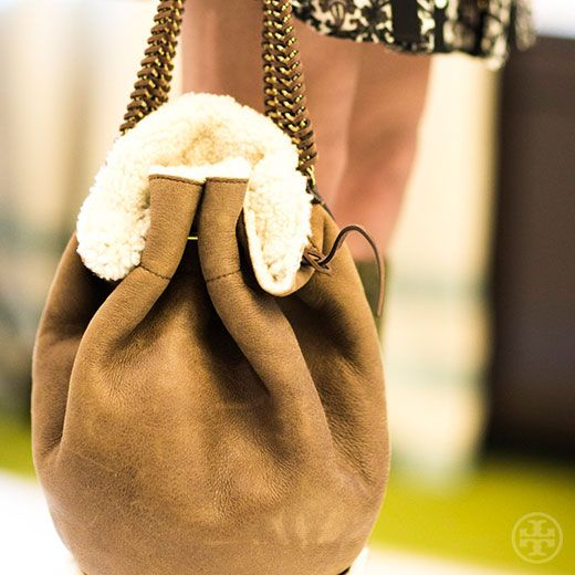 The right touch: a chain-handle suede bucket bag lined with shearling #toryburch #toryfall14  #nyfw