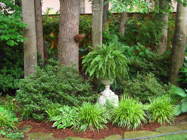 Shades of Green    Plants like azaleas and daylilies have their seasons to flower but also play a part in the design when foliage is the main star. In this serene garden, a fern on a pedestal is the finishing touch in a planting bed that features tonal, textural and height changes, in addition to the structural quality of the tree trunks. Posted by RMSer mimisharpe
