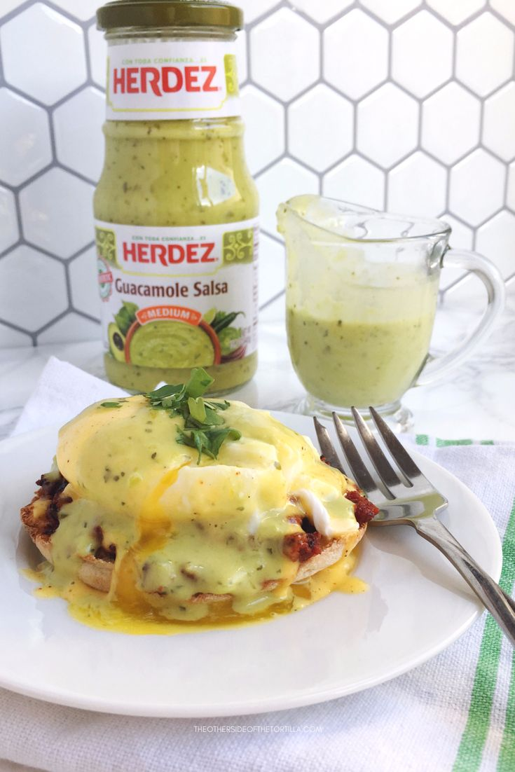 How to make Mexican eggs Benedict with chorizo, homemade ancho hollandaise sauce, and topped with Herdez guacamole salsa