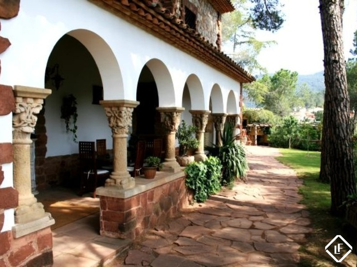 Spanish house huge wrap around deck interior design for House wrap definition