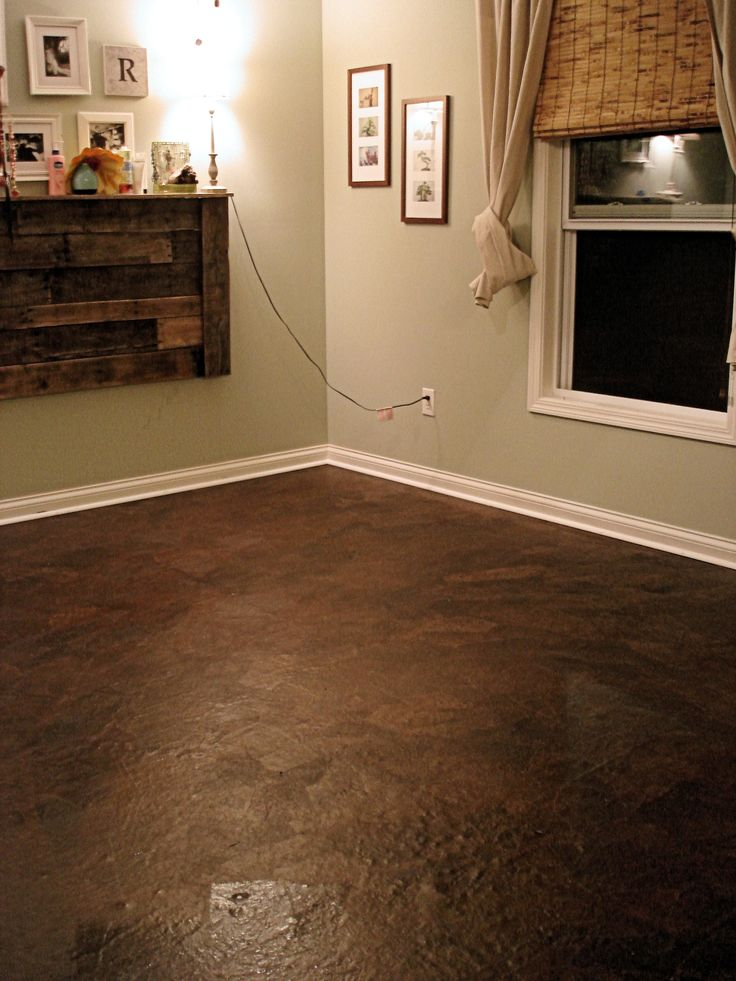 This floor was done using brown paper bags as the actual flooring. This is absolutely beautiful! Great pictures and step by step:)