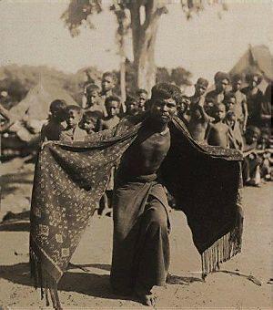 Lamaholot man dancing in ikated shawl Flores