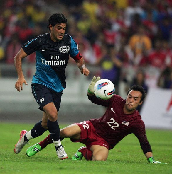 Carlos Vela, goal keeper of Arsenal, competes with Mohd Nasril of Malaysia during the pre-season Asian Tour friendly match between Malaysia and Arsenal at Bukit Jalil National Stadium on July 13, 2011 in Kuala Lumpur, Malaysia.