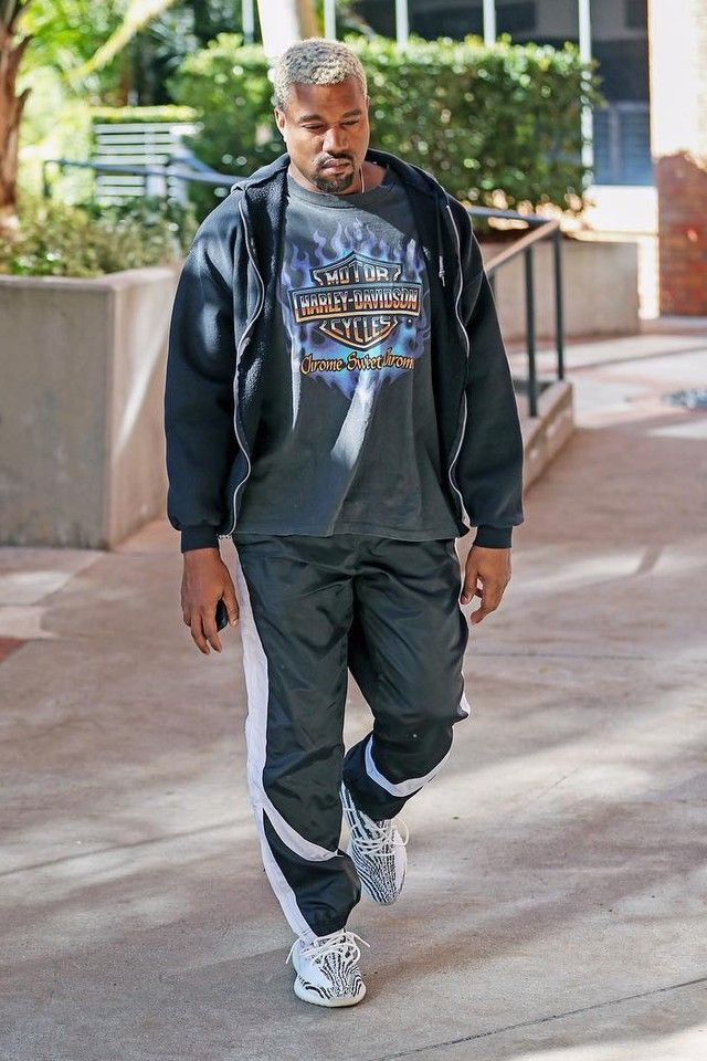 Kanye West wearing Reebok Track Pants, Vintage 1990s Chrome Sweet Chrome  T-Shirt,