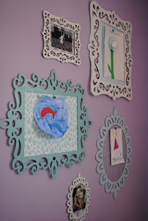 wall of scripture made with painted laser cut frames from michaels scrapbook paper and a hot glued binder clipcould add photos or print off decorative