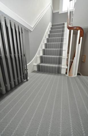 Herringbone flatweave stair runner with co-ordinating landing carpet by Bowloom Ltd.