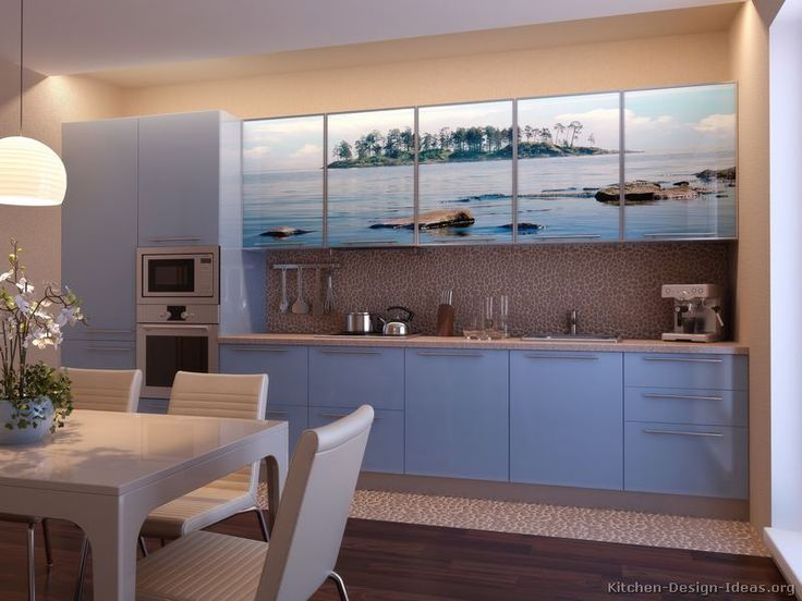 kitchen of the day a contemporary kitchen with sky blue cabinets a pebble stone backsplash and an ocean island photo print placed on the upper cabinet
