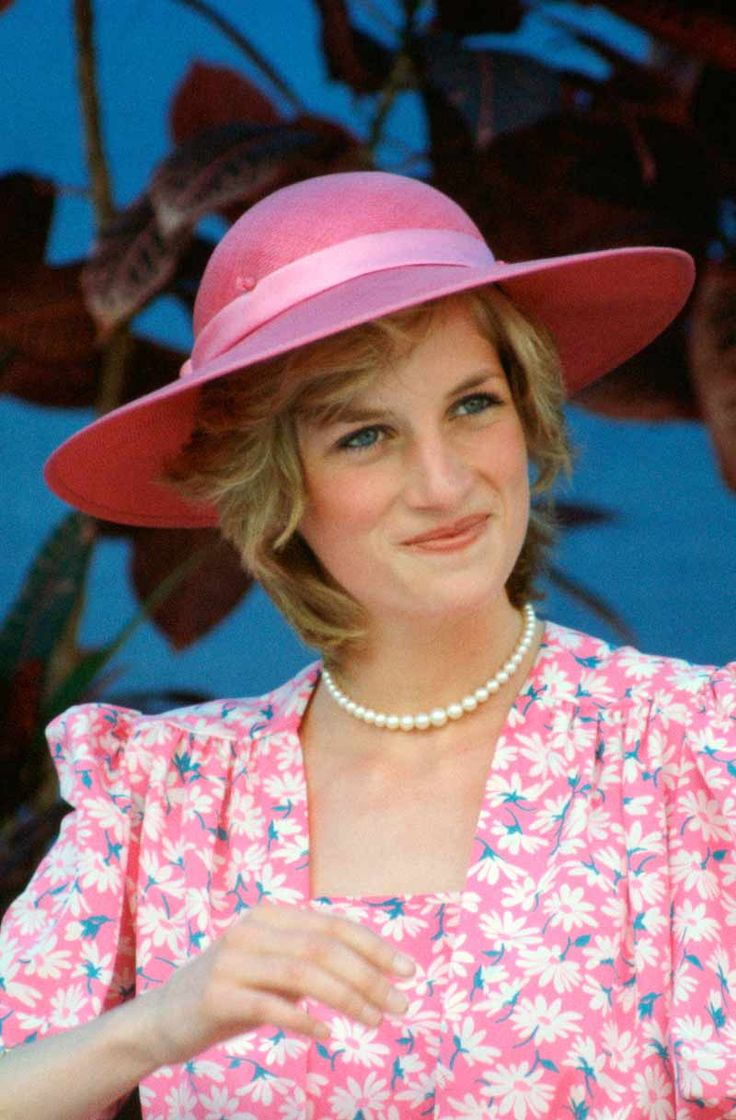 Princess Diana at the Sydney Opera House in Sydney, Australia wearing pink & white crepe dress by Bellville Sassoon & a wide brimmed hat by John Boyd March 1983. Diana wore this same outfit for Prince William's christening.