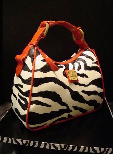 Dooney and Bourke Zebra bag cake by debbiedoescakes...... THIS IS A CAKE SHUT THE FRONT DOOR