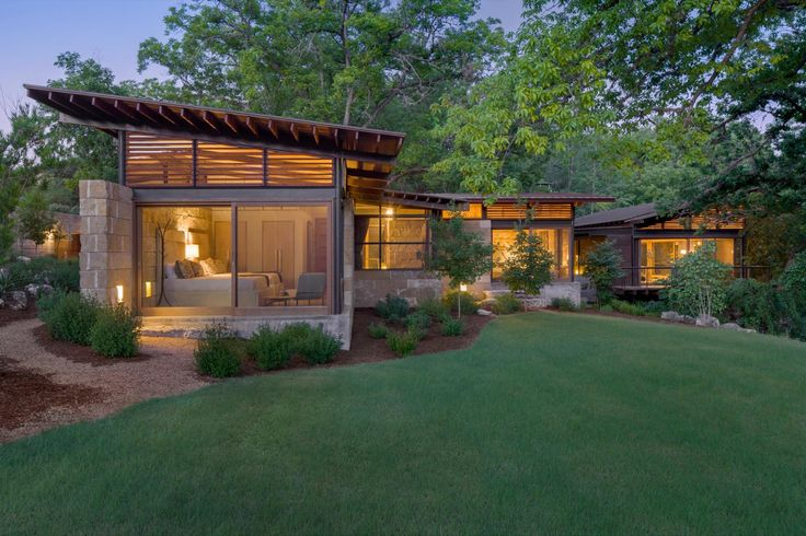 Nestled at the confluence of two creeks on a Texas Hill Country Ranch, Mill Springs Homestead provides a water's edge retreat. Four structures organize around the site of a 20th century dam, forming a courtyard shaded by mature pecan trees and an intimate connection to cool creeks.Anchored to thedam, the main living and gathering area provides dynamic views of thecreeks and valley landforms shaped by time.