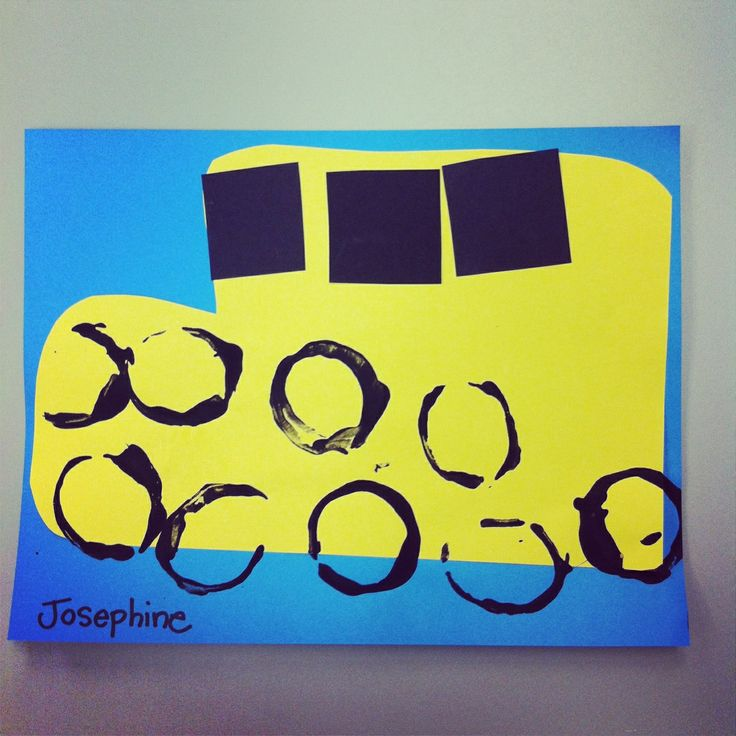 School bus craft using toilet paper roll tube dipped in black paint for wheels.