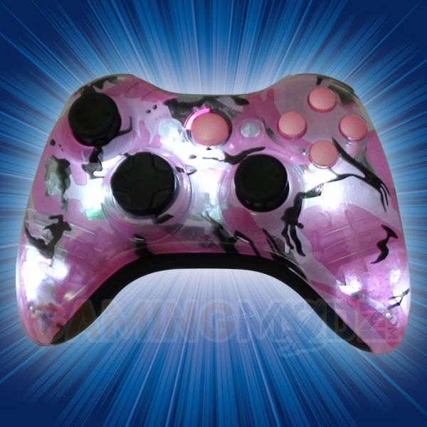 This is our Pink Camo Illuminating Modded Xbox 360 Controller. We have released our extreme edition series of modded xbox 360 controllers and this model is one of the newest in that series. You can purchase this controller and many other custom Xbox 360 controllers exclusively at GamingModz.com! Watch the video now: http://www.youtube.com/watch?v=8myKPRZrUz4
