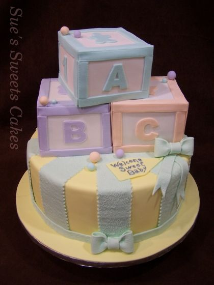 This Beautiful Baby Shower Cake Features Pastel Baby Blocks That Were  Carved Out Of Cake.