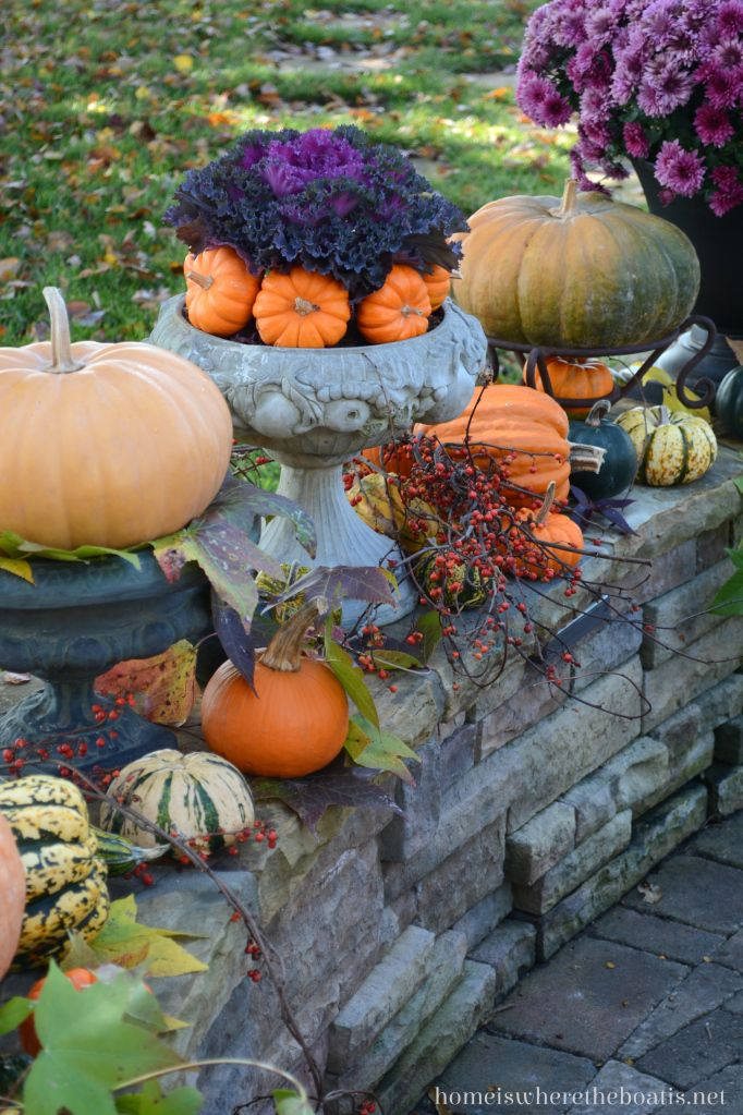 Pumpkins with fall leaves, mums, bittersweet vine, and kale | homeiswheretheboatis.net #fall