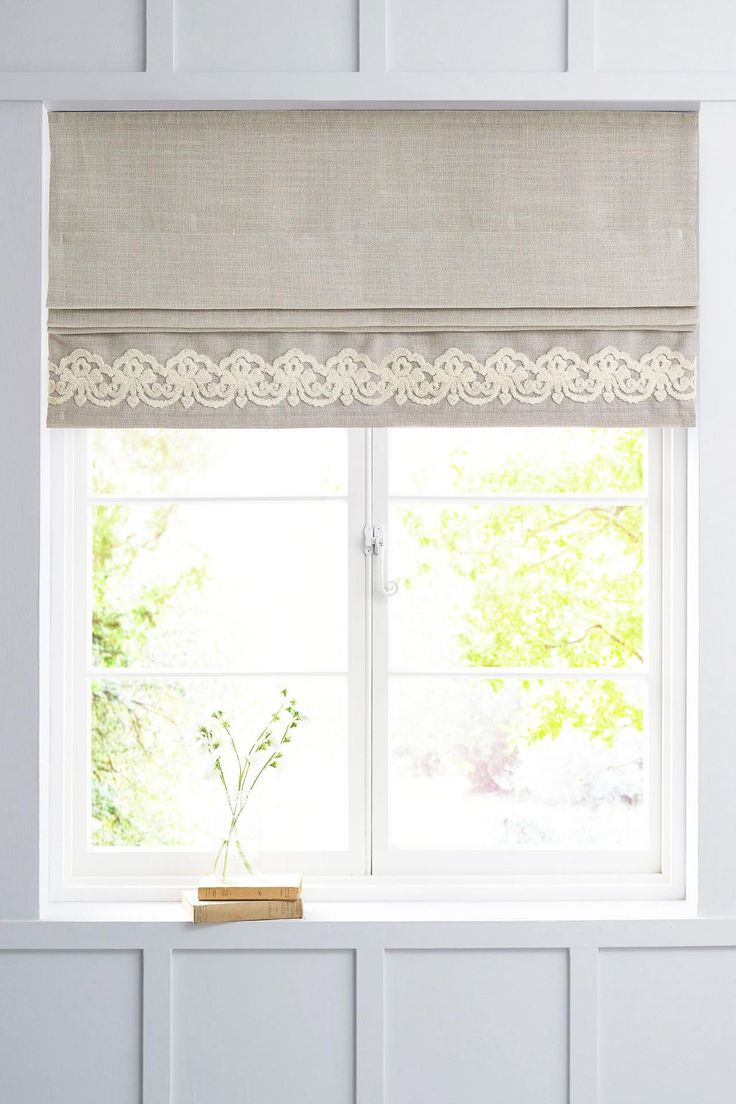 Embroidered roman blinds