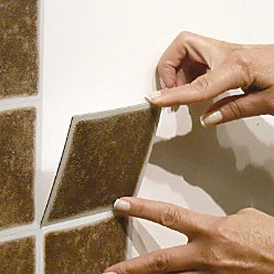 anyone ever used these? do they remove easily? self-stick vinyl wall tiles