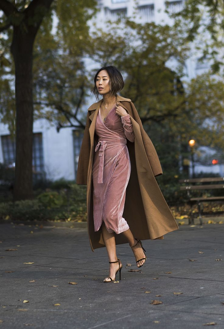 Aimee Song of the blog Song of Style shares photos from her recent trip to New York City, wearing a Keepsake velvet dress with velvet pumps.