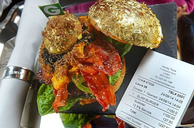 """World's most expensive Burger""....Priced at or £1237.50  Kobe wagyu beef & New Zealand venison with Himalayan salt. At the centre is a black truffle Brie, topped with bacon coated with maple syrup, along with beluga caviar and a hickory smoked duck egg covered in gold leaf. Bun coated in gold leaf, garnish is a mango and champagne jus with grated white truffle. Served with a Canadian lobster poached in Iranian saffron."