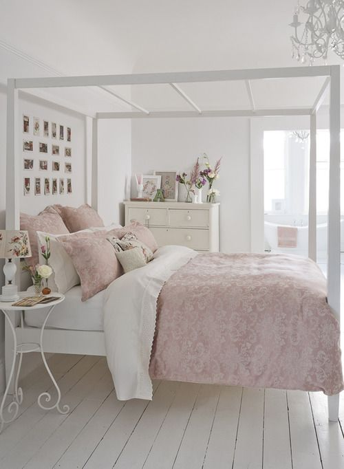 Pale Pink and White bedroom. Framed bed and bedhead.
