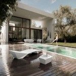 Fabulous Backyard Home Design with Elongated Swimming Pool and Wooden Deck