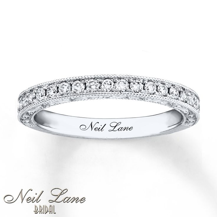 Shimmering diamonds and milgrain detailing adorn this glamorous wedding band from Neil Lane Bridal®. Vintage-inspired intricate designs adorn the profile. The ring has a total diamond weight of 1/3 carat and features Neil lane's signature inside the band. Diamond Total Carat Weight may range from .29 - .36 carats.