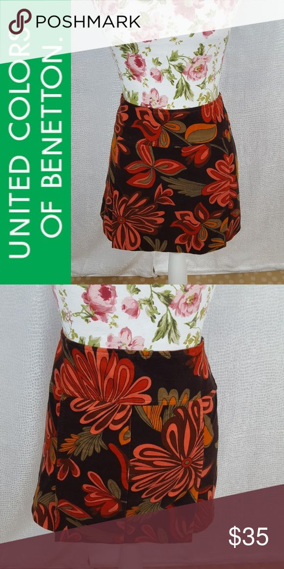 UNITED COLORS OF BENETTON Mod Velvet Skirt A fun mod Floral Pattern covers this skirt. Material is a brushed velvet and it has four slits, two in the front and two in the back. Hidden Side zip. EUC.  Length: 14 1/2 inches  Waist: 16 1/2 inches laying flat United Colors Of Benetton Skirts Mini