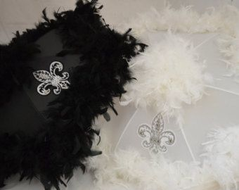 This listing is for 2 second line umbrellas, one white, one black, with boas and personalized ribbon. Yes, you get TWO umbrellas for this price! Yes, you get TWO umbrellas for this price! Just let me know what you want on your ribbons in the note section when you check out to purchase. Copy and paste this in the note section when you order your 2 umbrellas: 1.What you want printed on the white ribbon, usually the brides first name: 2.What you want printed on the black ribbon usually the…