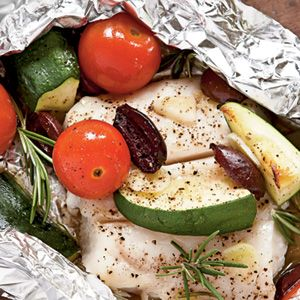 Halibut with Tomatoes, Rosemary, and Zucchini in Foil PacketsHalibut Grilled, Grilled Fish, Coastalliving Com, Seafood, Sea Food, Packets Recipe, Coastal Living, Rosemary, Foil Packets