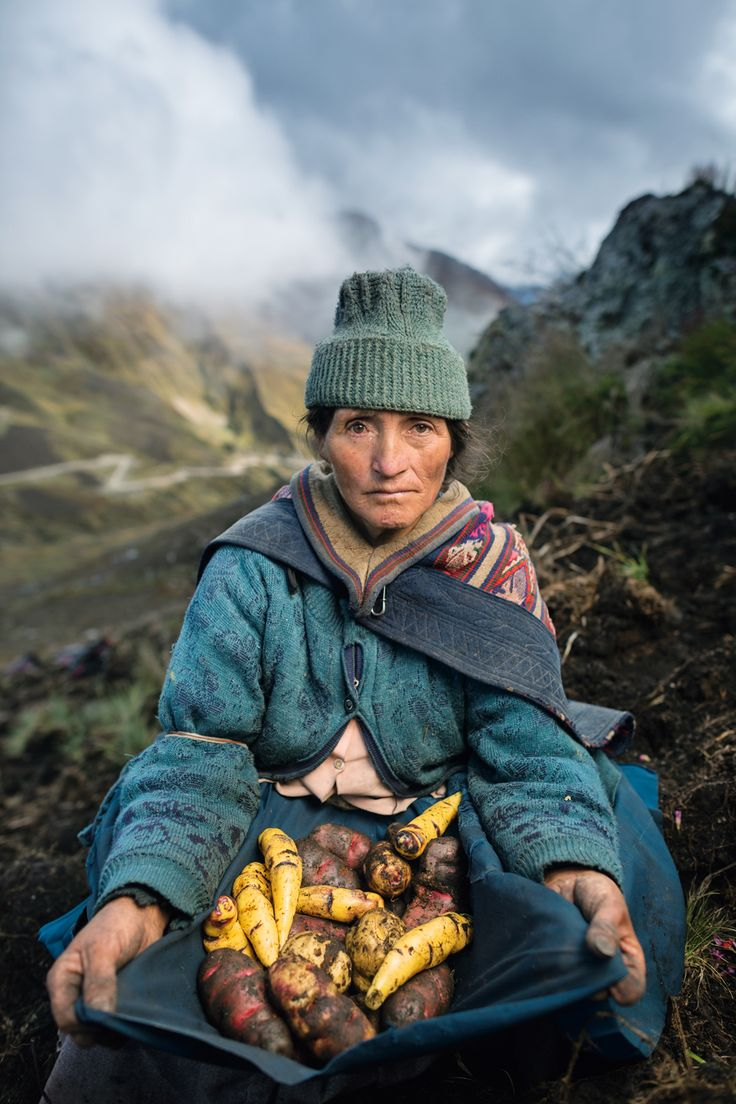 High in the Peruvian Andes, Estela Cóndor grows five different varieties of potatoes to sell in the market, along with a yellow tuber called mashua that she cooks for her family | Jim Richardson, National Geographic