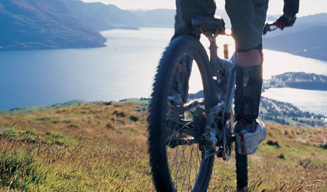 Out for a ride overlooking Lake Wakatipu and Queenstown, New Zealand  Or you could consider a heli-bike trip...